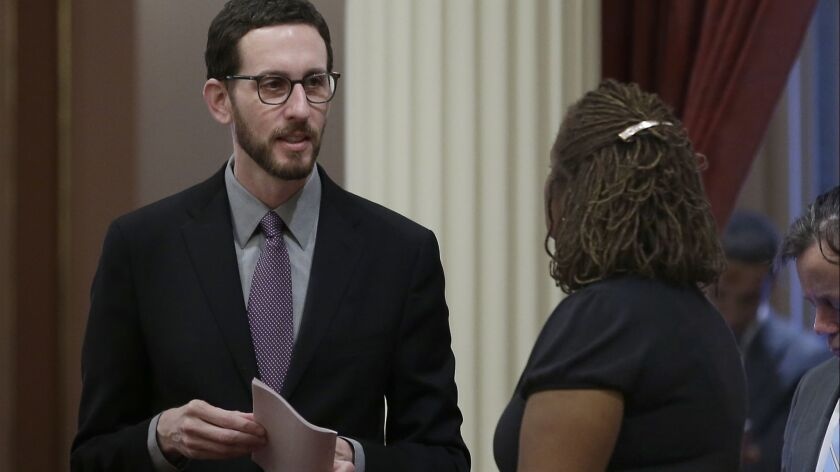 State Sen. Scott Wiener (D-San Francisco), left, talks with Sen. Holly Mitchell (D-Los Angeles) at the state Capitol.