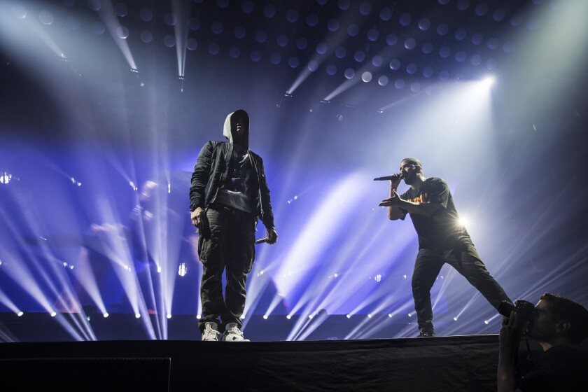 Amid social media rumors that the two rappers are feuding, Eminem made a guest appearance on stage in his hometown of Detroit during Drake's concert at the Joe Louis Arena.