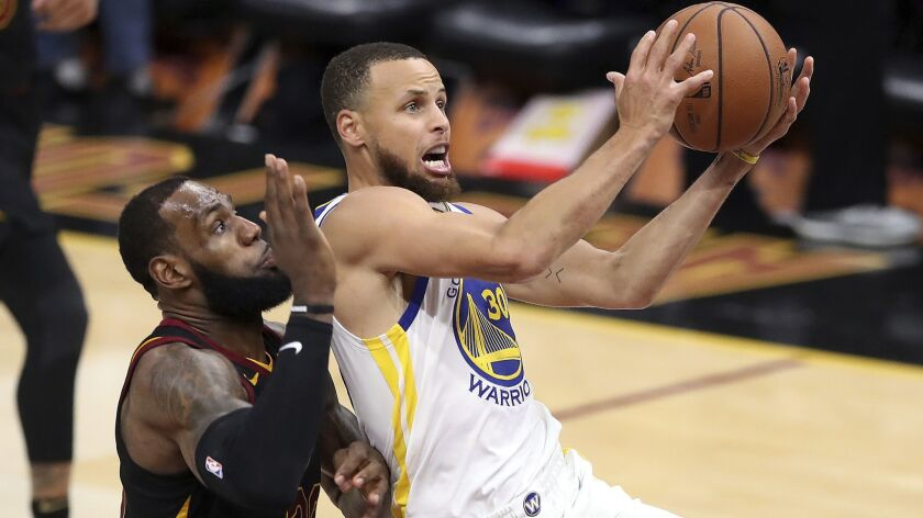 FILE - In this June 6, 2018 file photo, Golden State Warriors' Stephen Curry goes to the basket agai