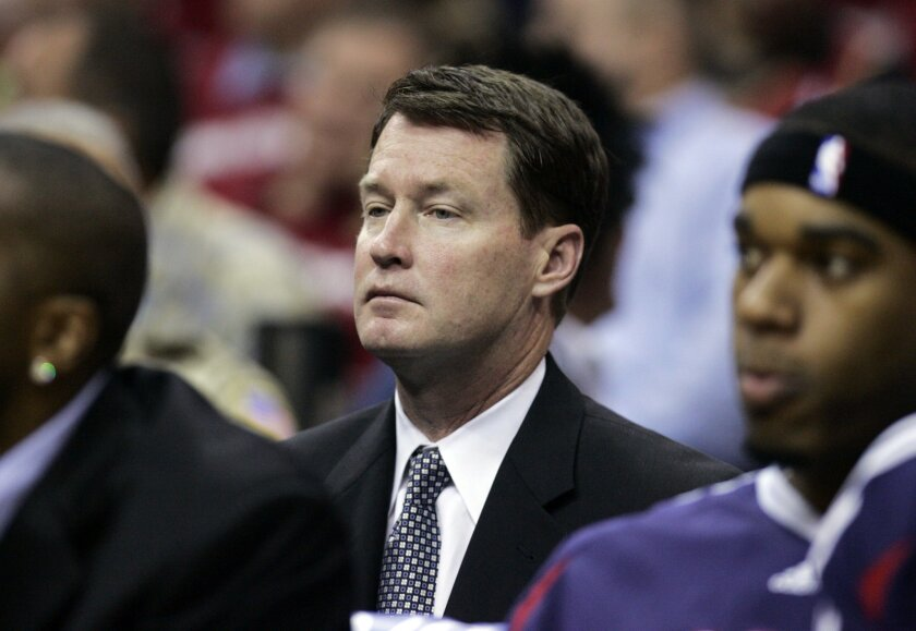FILE - In this May 7, 2009, file photo, Atlanta Hawks assistant Mark Price looks on during an NBA Eastern Conference semifinal basketball game against the Cleveland Cavaliers in Cleveland. Price, a former sweet-shooting All-Star guard for Cleveland, will interview for the team's coaching job, a person familiar with the meeting told The Associated Press. Price is scheduled to sit down with members of the Cavs' front office on Tuesday, June 10, 2014, said the person who spoke Monday on condition of anonymity because the team is not making any plans public. (AP Photo/Tony Dejak, File)