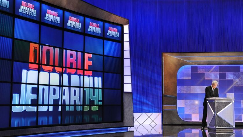 """Host Alex Trebek rehearses his lines on the set of a """"Jeopardy!"""" taping."""