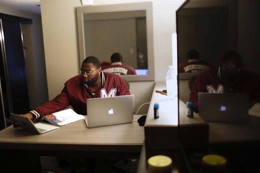 """Morehouse College senior Lanarion """"LTL"""" Norwood Jr. works on his computer"""