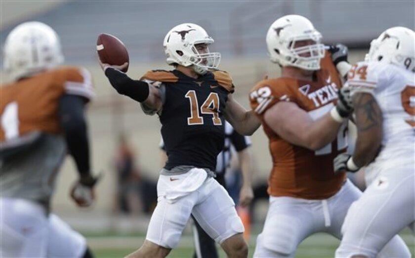 Texas quarterback David Ash (14) throws a pass during the NCAA college football team's spring game, Saturday, March 30, 2013, in Austin, Texas. (AP Photo/Eric Gay)
