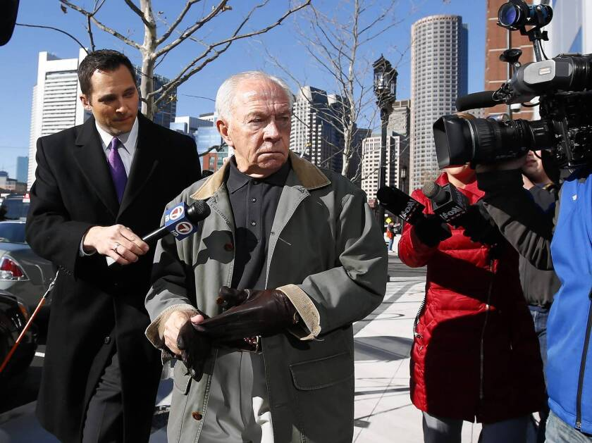 """Jackie Bulger leaves federal court in Boston after the sentencing of his brother, crime boss James """"Whitey"""" Bulger. He declined to respond to reporters' questions."""