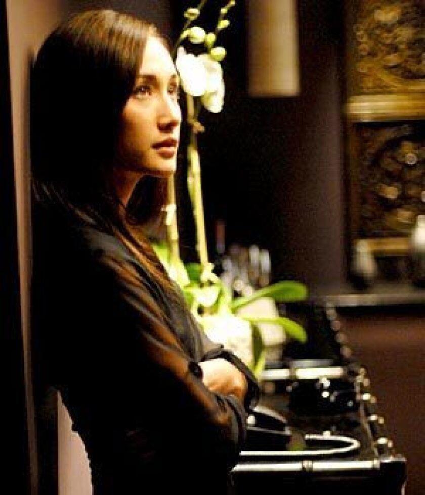 "Longing: Maggie Q in ""Deception"""