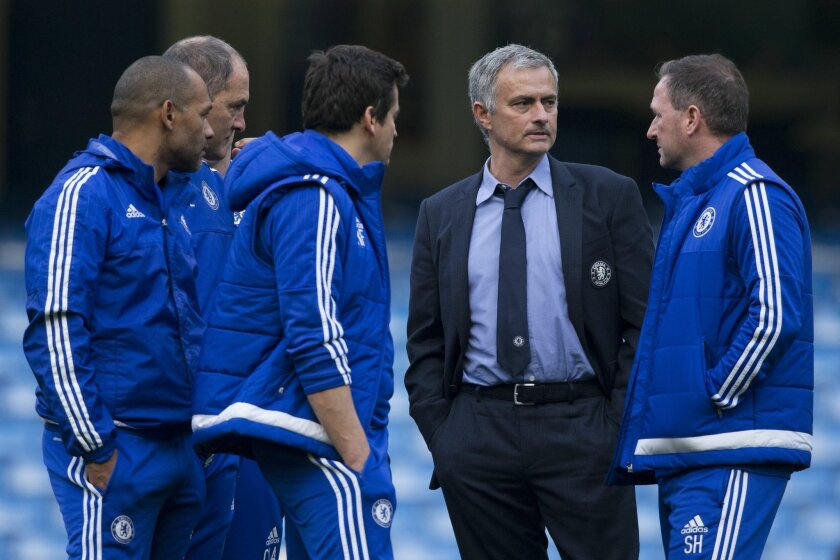 Chelsea's head coach Jose Mourinho, second right, talks with his coaching staff after coming back out onto the pitch after the English Premier League soccer match between Chelsea and Liverpool at Stamford Bridge stadium in London, Saturday, Oct. 31, 2015.  Liverpool won the match 3-1.  (AP Photo/Ma