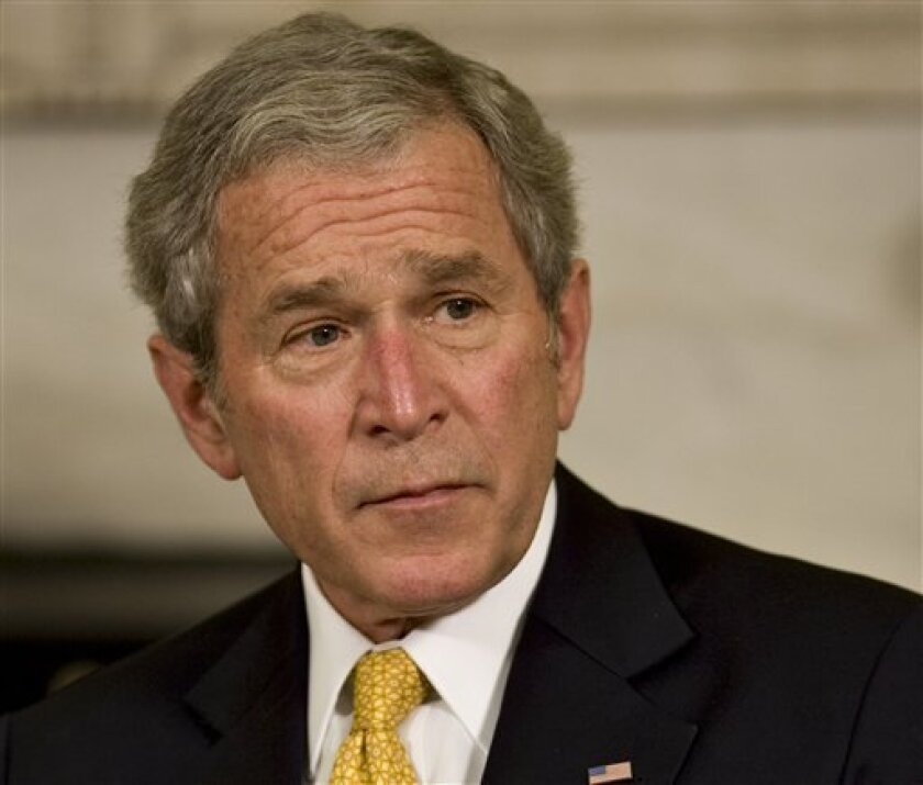 President George W. Bush makes a statement during his meeting with Mexican President Felipe Calderon, not shown, Tuesday, Jan. 13, 2009, in the Oval Office at the White House in Washington.  (AP Photo/J. Scott Applewhite)