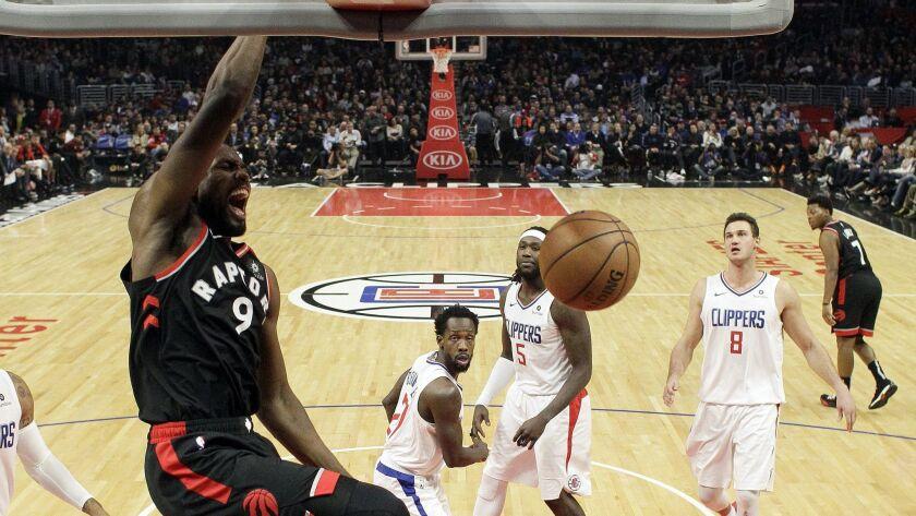 Toronto Raptors' Serge Ibaka (9) dunks against the Clippers.