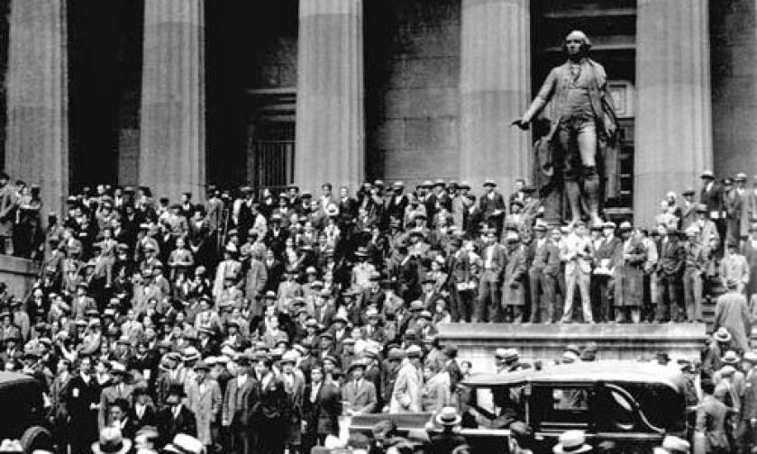 Hordes of investors and others gather outside the New York Stock Exchange on Oct. 24, 1929, shortly before the historic stock market crash that ushered in the Great Depression.