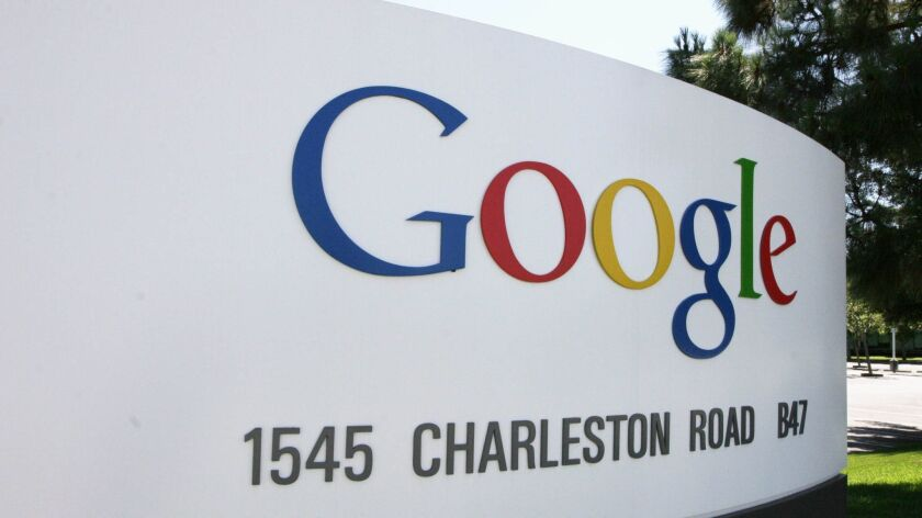 A sign outside Google headquarters is seen in Mountain View, Calif.