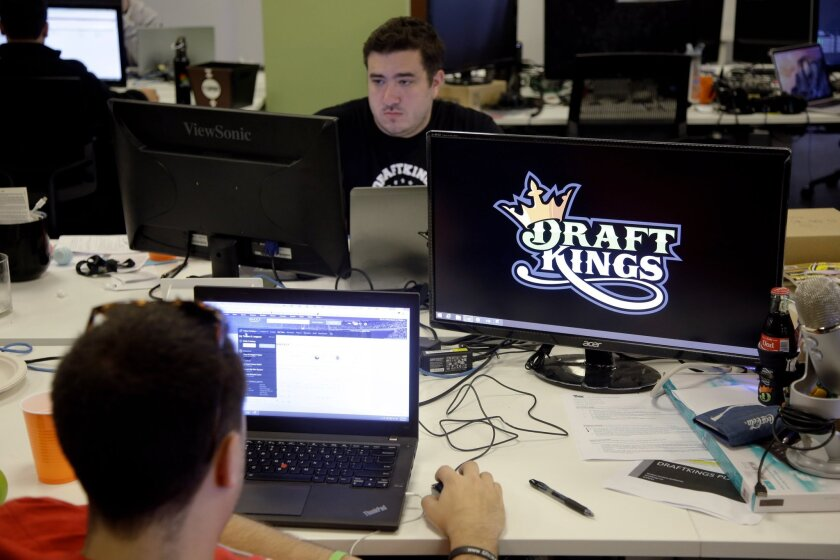 DraftKings employees work at the company's offices in Boston last month.