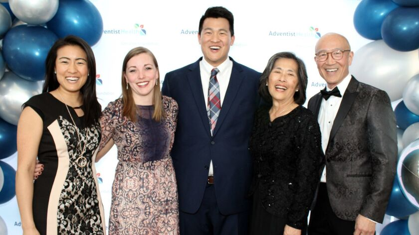 Posing for a family photo at the Adventist Health Glendale Gala are, from left, Jessica Lew, Crysta