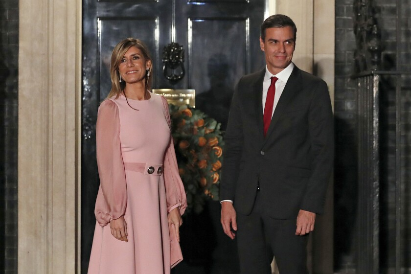 FILE - In this Dec. 3, 2019, file photo, Spanish Prime Minister Pedro Sanchez and his wife Begona Gomez arrive at 10 Downing Street in London. Spain's government said Saturday March 14th, 2020 that the wife of Prime Minister Pedro Sanchez has tested positive for the new coronavirus. It said Begona Gomez and the prime minister are in good health and following the instructions of medical authorities at their residence in La Moncloa Palace in Madrid, the government seat. The vast majority of people recover from the new coronavirus. According to the World Health Organization, most people recover in about two to six weeks, depending on the severity of the illness. (AP Photo/Alastair Grant, File)