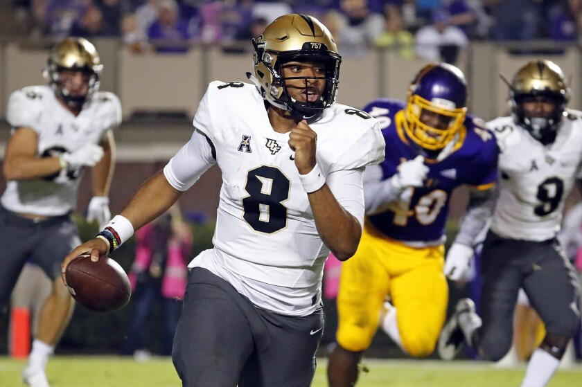 Central Florida quarterback Darriel Mack Jr. (8) looks to pass during the first half of an NCAA coll