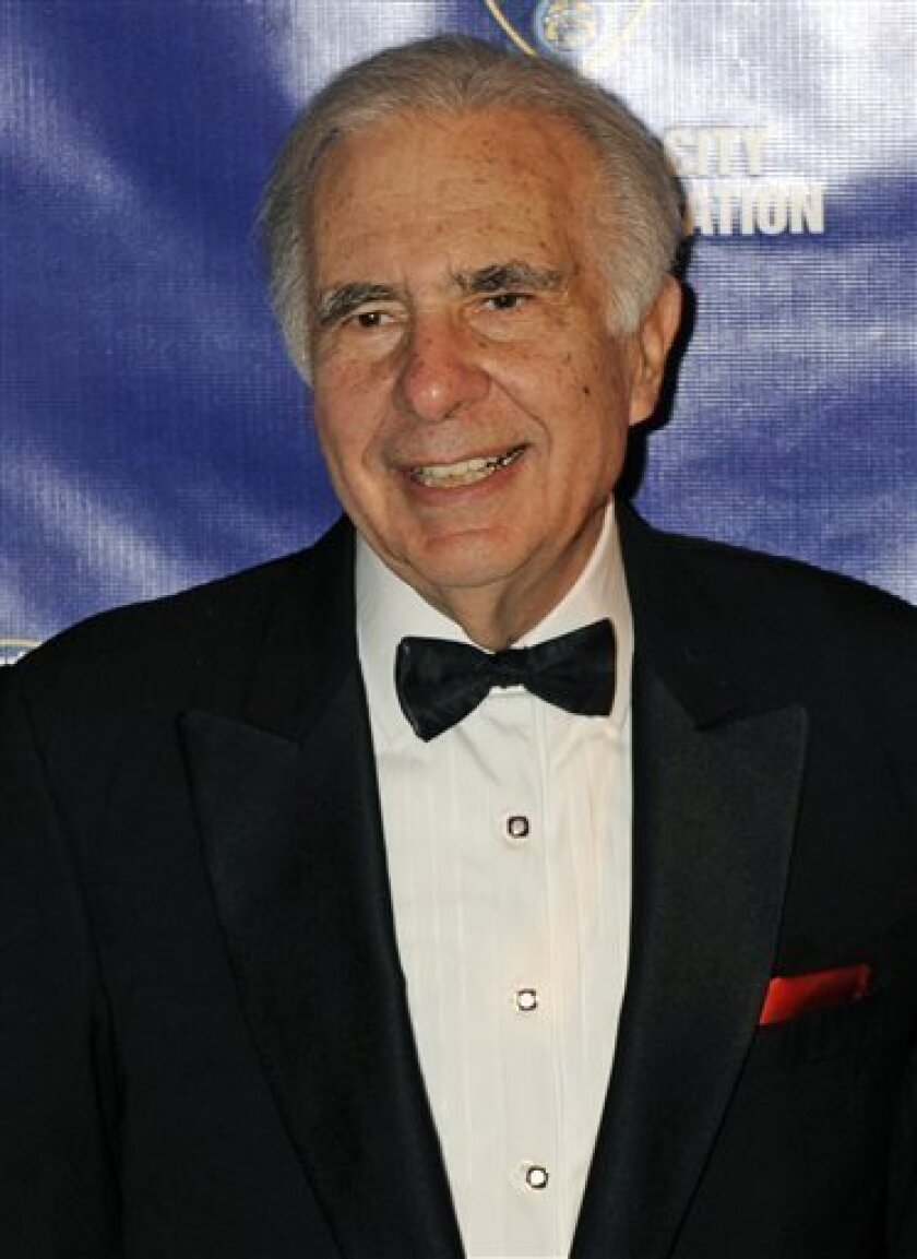 FILE - In this March 16, 2010 file photo, financier Carl Icahn poses for photos upon arriving for the 32nd annual New York City Police Foundation Gala in New York. In a Wednesday, Oct. 31, 2012 regulatory filing, Icahn revealed he had used some of his $14 billion fortune to accumulate a 10 percent stake in Netflix Inc. (AP Photo/Henny Ray Abrams, File)