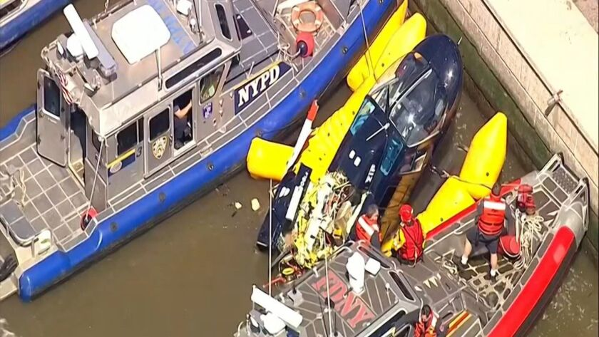 In this image made from video provided by WABC-TV, harbor units from the New York City police and fi