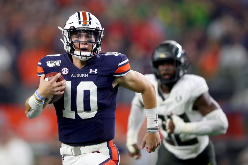 Auburn quarterback Bo Nix carries the ball against Oregon in the second quarter during the Advocare Classic on Saturday in Arlington, Texas.