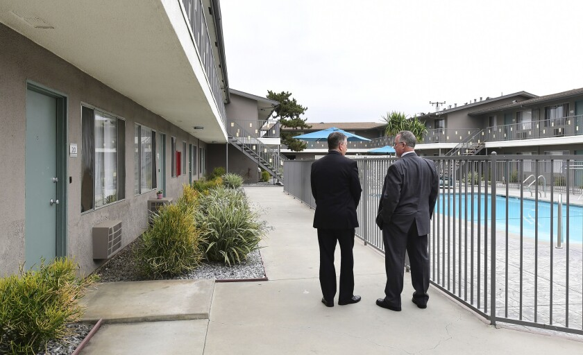 Los Angeles County Deputy District Attorney Dan Akemon, left, and detective Tom Small review the vie