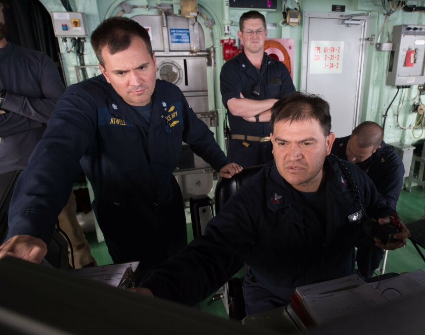 Cmdr. Michael Atwell, commanding officer of LCS Crew 101, observed Engineman 1st Class Silvano Becerra working aboard the Fort Worth on Dec. 16, 2015 in the South China Sea / photo courtesy of U.S. Navy