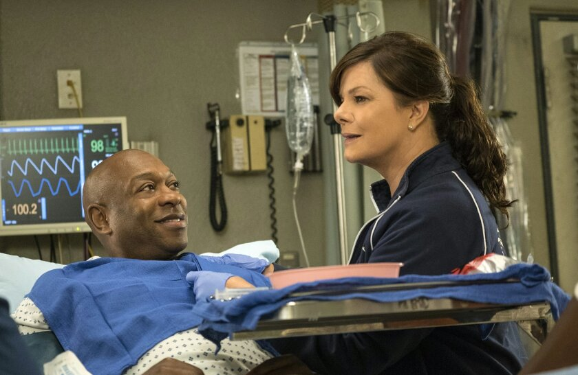 """In this image released by CBS, Marcia Gay Harden, right, and Alton Fitzgerald White appear in a scene from the series """"Code Black."""" scheduled to air on Nov. 25, 2015 on CBS. White, who has played the role of """"Mufasa"""" in """"The Lion King"""" over 4000 times, guest stars. (Monty Brinton/CBS via AP)"""