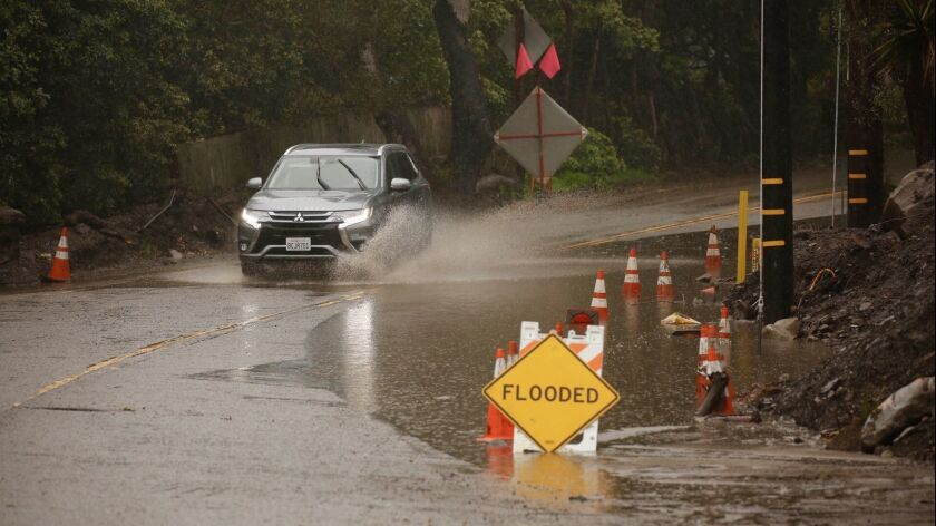 MONTECITO CA MARCH 21, 2018 -- Signs of water ponding along East Valley Road near San Ysidro Creek