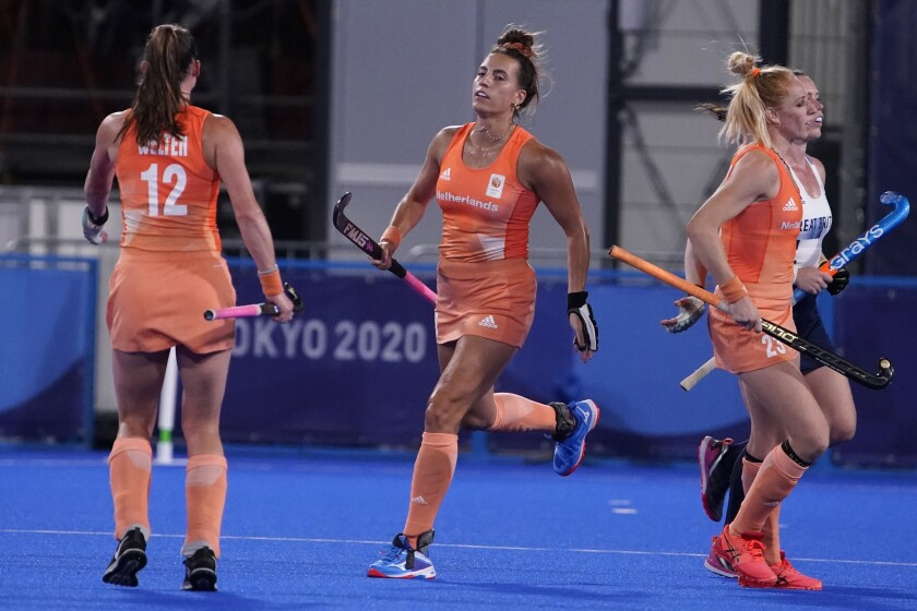 Netherlands' Frederique Matla, center, celebrates after scoring against Britain during a women's field hockey match at the 2020 Summer Olympics, Thursday, July 29, 2021, in Tokyo, Japan. (AP Photo/John Locher)
