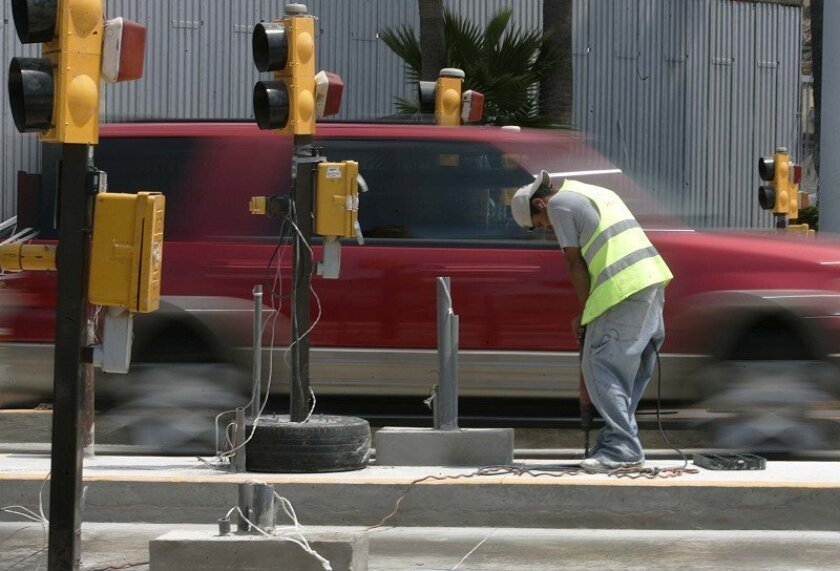 A worker drilled a hole in a utility box last week as part of the  installation of an electronic customs inspection system on the Mexican side of  the San Ysidro border crossing.