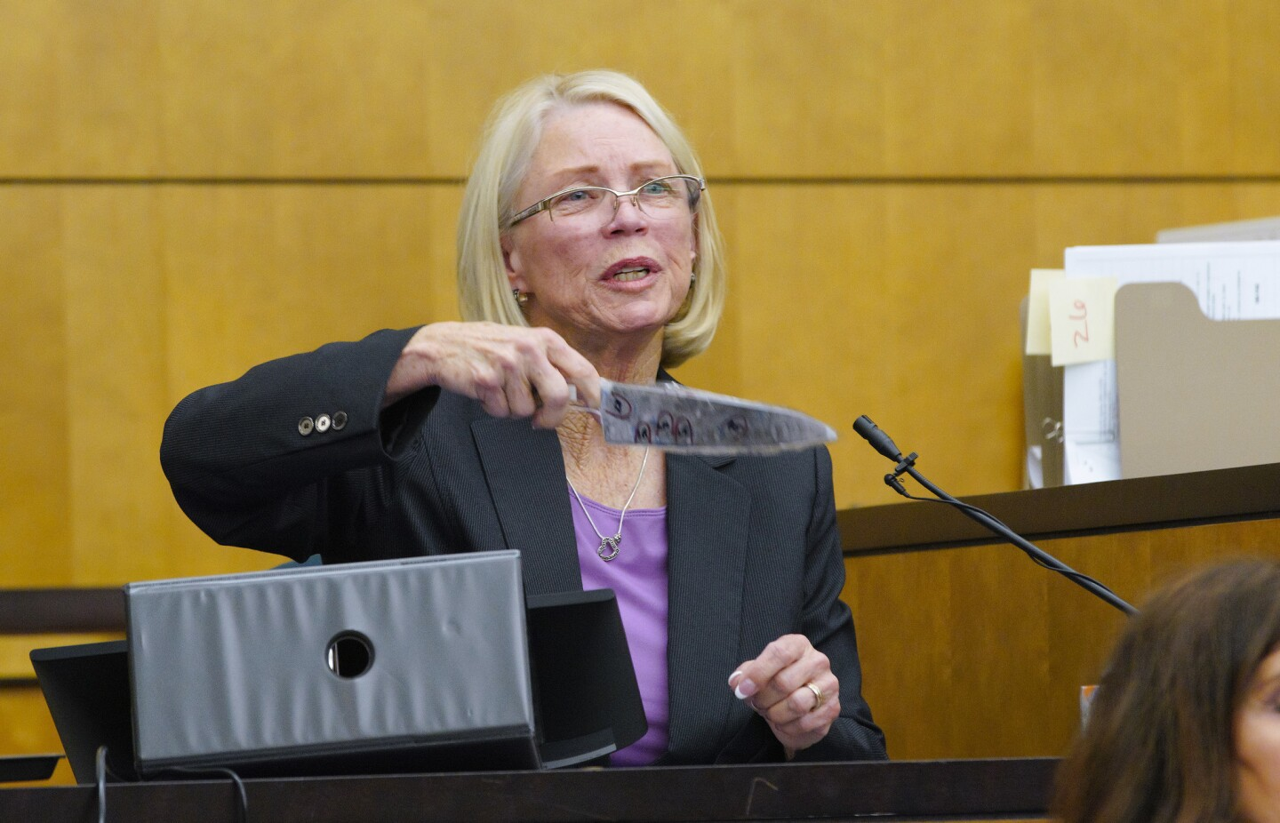 During redirect of her testimony, Denys Williams a former forensic evidence technician holds a replica of the knife that was found at the Coronado residence of where Rebecca Zahau's body was found.