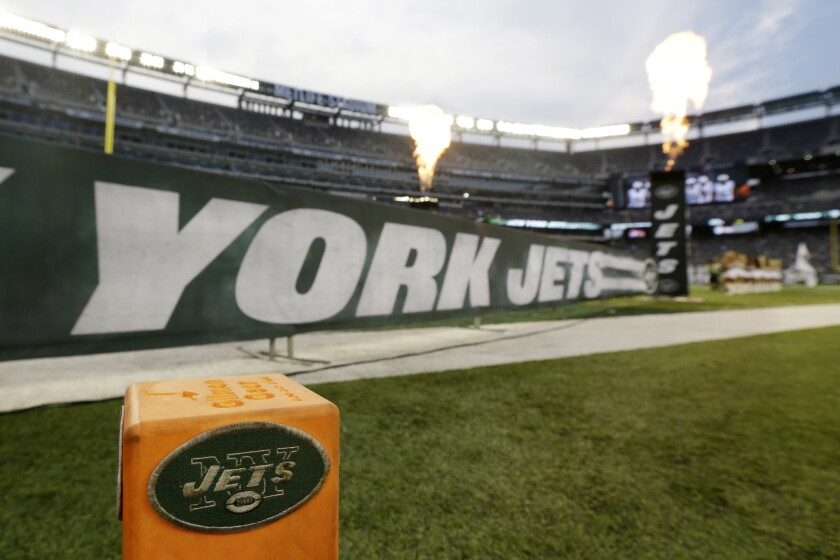 The New York Jets logo is seen on a pylon.