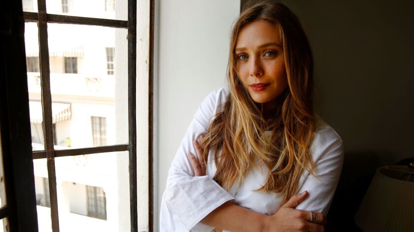 Olsen looks out at the view from Room 64 at the Chateau Marmont.
