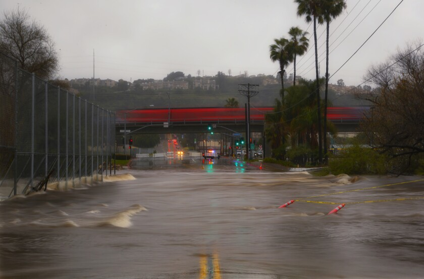On Monday Fashion Valley Road between Hotel Circle and Friars Road closed due to flooding from Monday's rain weather.