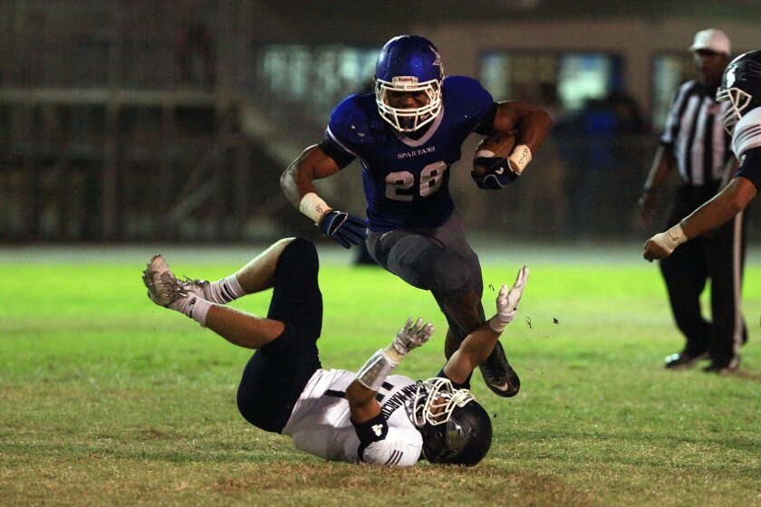 Jaylon Candler tries to break a tackle for Chula Vista, which plays Sweetwater on Friday night.