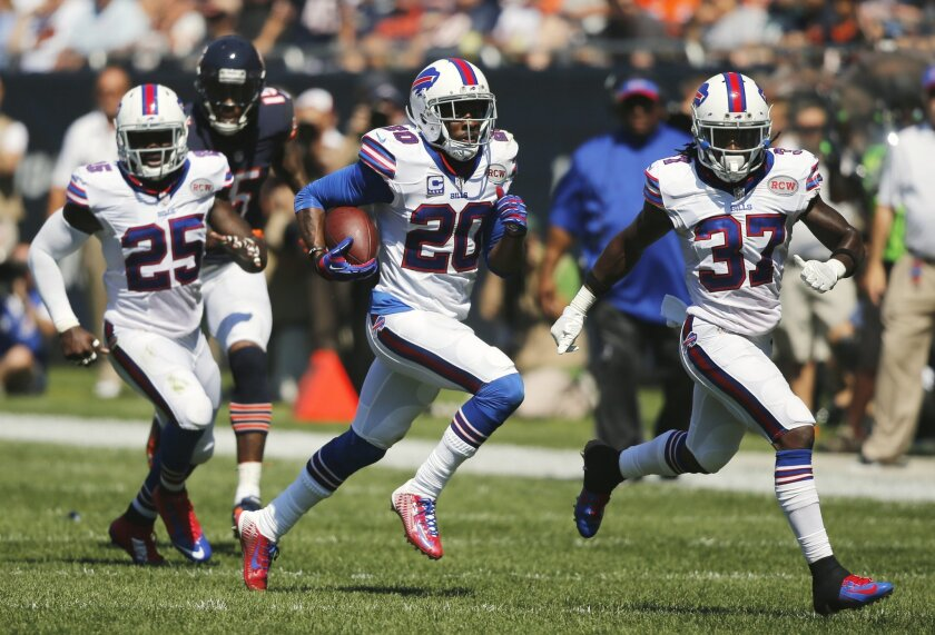 Buffalo Bills cornerback Corey Graham (20) runs after intercepting a pass thrown by Chicago Bears quarterback Jay Cutler in the first half of an NFL football game Sunday, Sept. 7, 2014, in Chicago. (AP Photo/Charles Rex Arbogast)