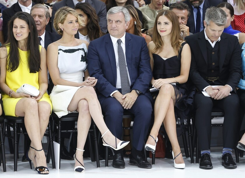 Jennifer Lawrence, Dior Chief Executive Sidney Toledano and Emma Watson attend the presentation of the Haute Couture Fall-Winter 2014/15 collection by Belgian designer Raf Simons for Christian Dior during Paris Fashion Week.
