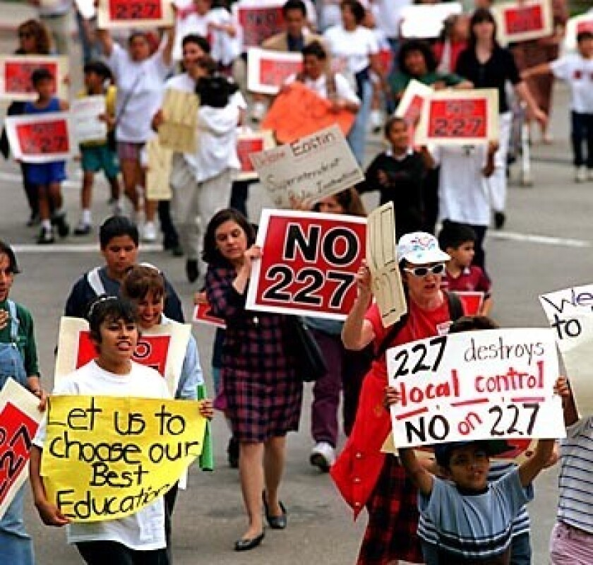 Students, parents and teachers opposed to Proposition 227 march toward a rally in Santa Ana in 1998.