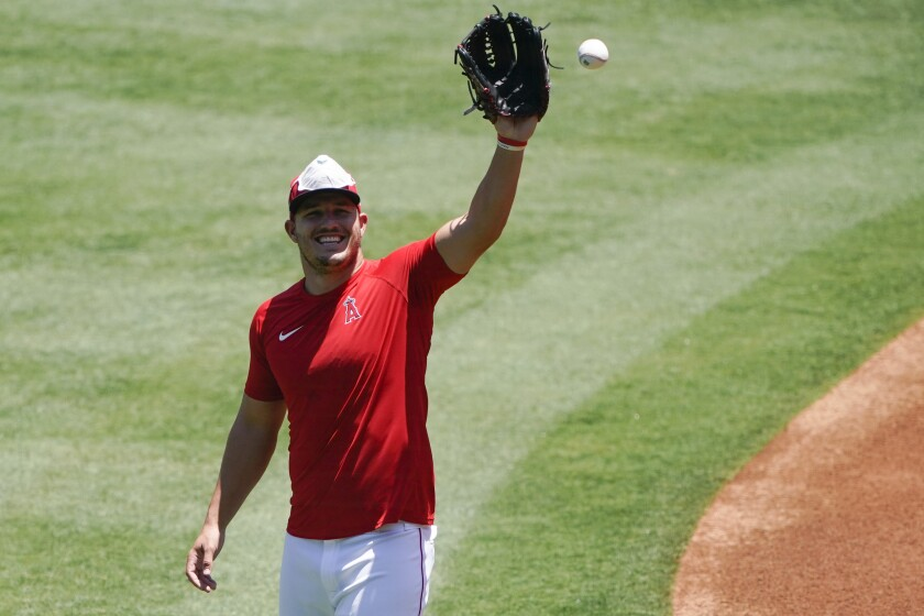Angels center fielder Mike Trout catches a ball during practice at Angel Stadium on July 7.