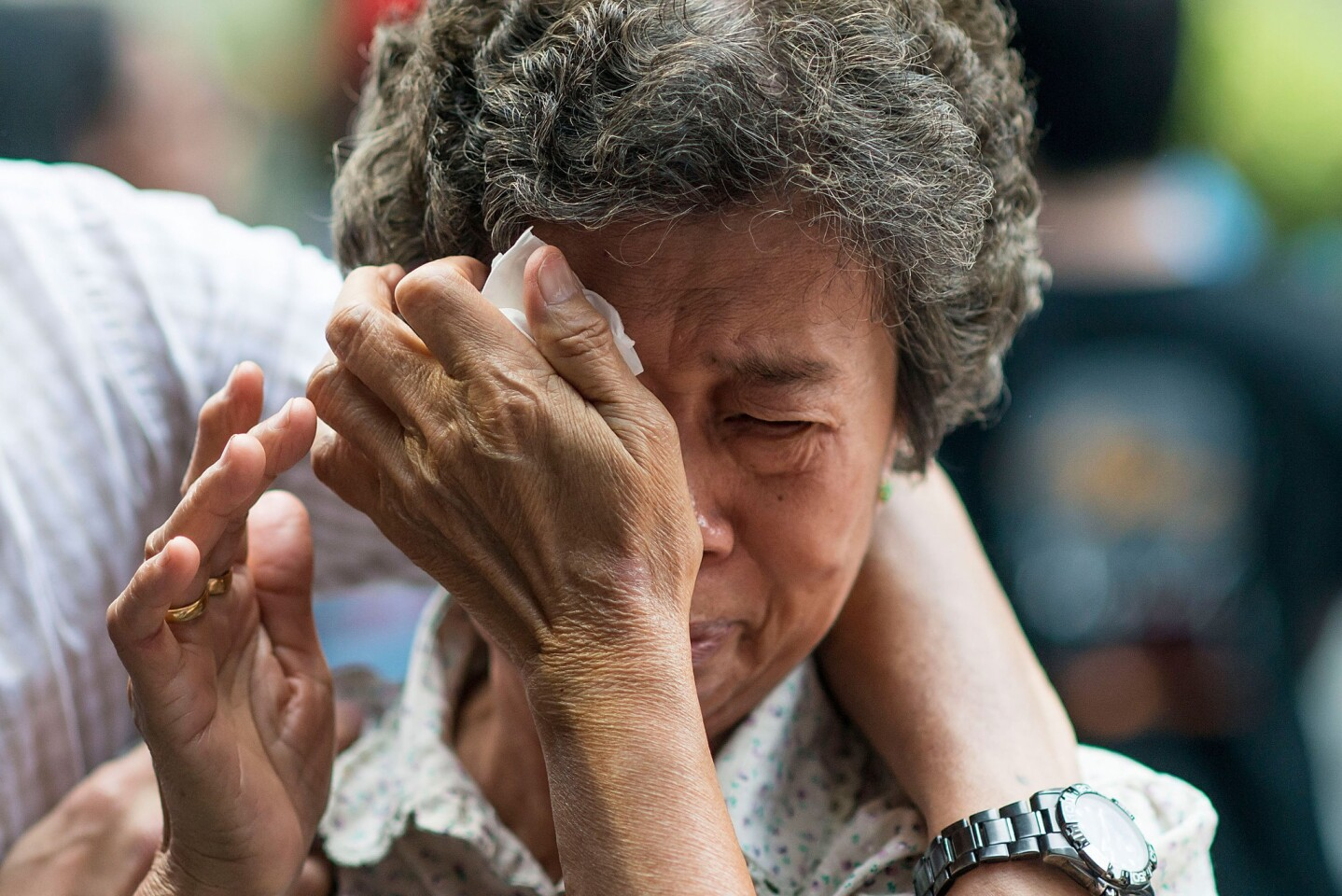 The mother of a Flight MH370 passenger reacts at a memorial service in Kuala Lumpur, Malaysia.