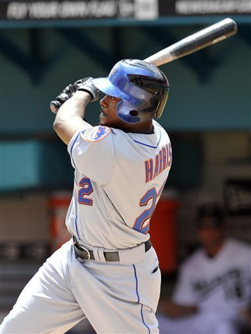 New York Mets' Willie Harris connects for a two-run home run during the first inning against the Florida Marlins during a baseball game in Miami, Sunday, April 3, 2011. (AP Photo/Steve Mitchell)
