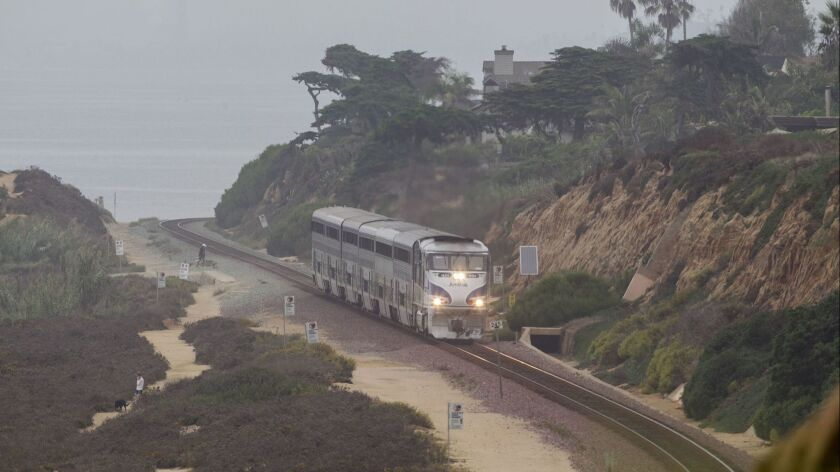 File photo of a southbound Amtrak train passing through the Torrey Pines Reserve in Del Mar.