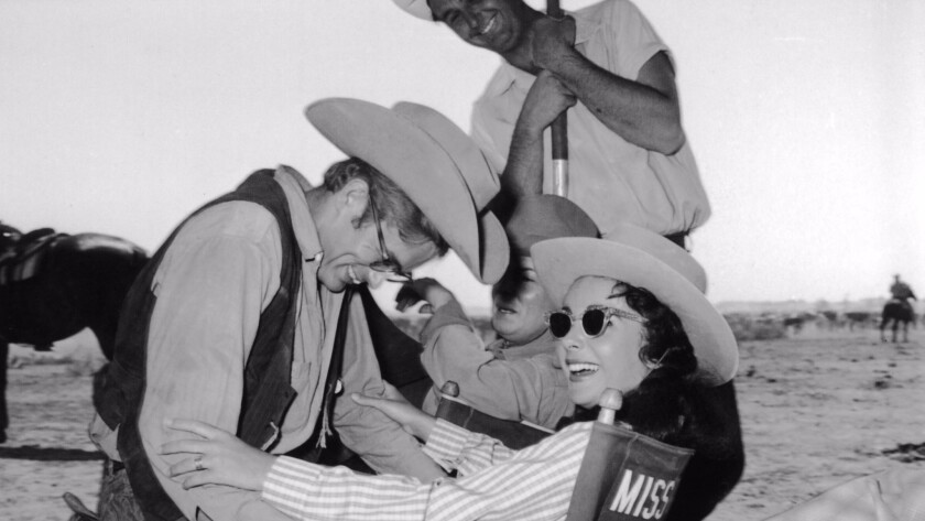 "James Dean and Elizabeth Taylor on the set of ""Giant."""