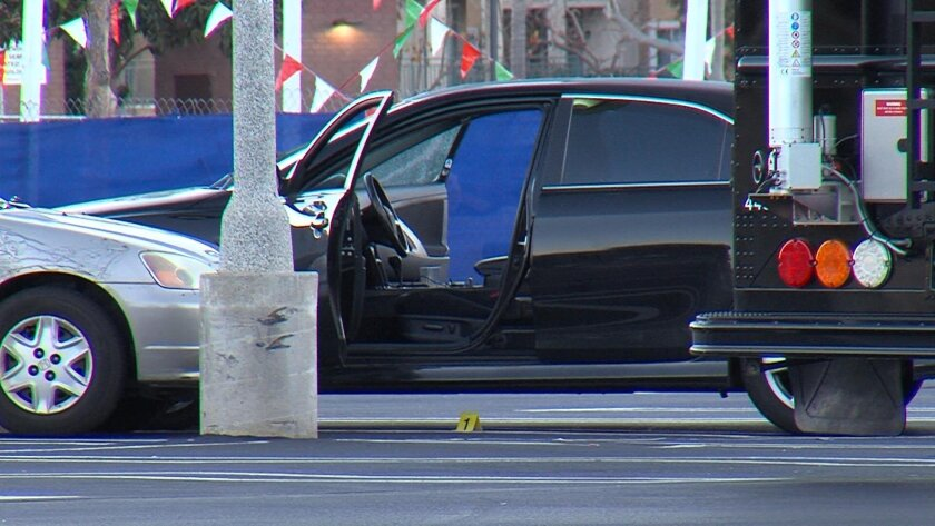 Police found  the shooting victims inside this car parked at the south end of the Westfield Mission Valley mall near a Macy's store and Christmas tree lot.