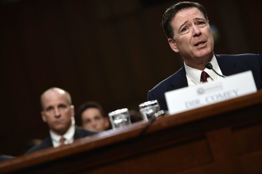 Former FBI Director James Comey testifies June 8 at a Senate Intelligence Committee hearing.