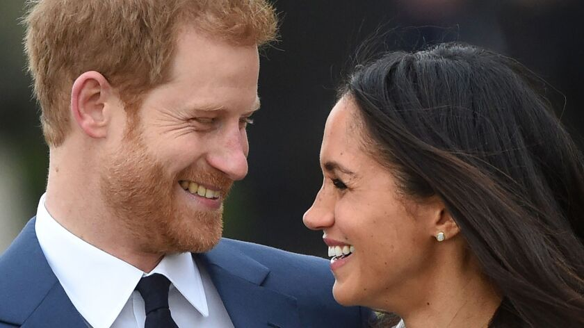 Prince Harry and Meghan Markle after announcing their engagement.