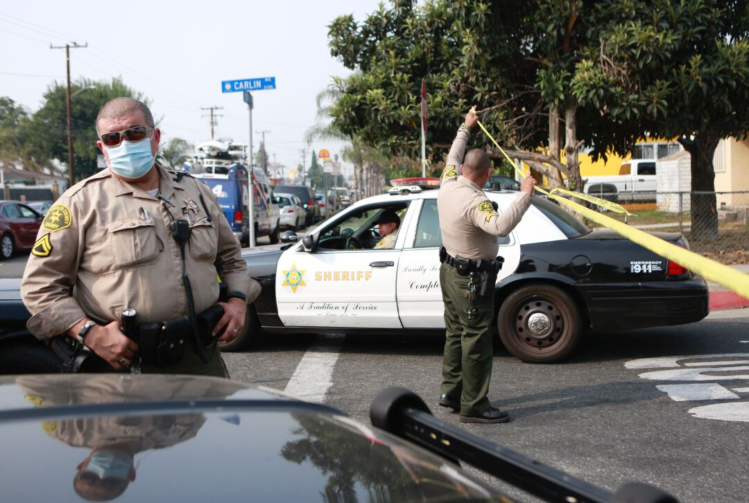 L.A. County sheriff's deputies surround a home on Carlin Avenue in Compton.