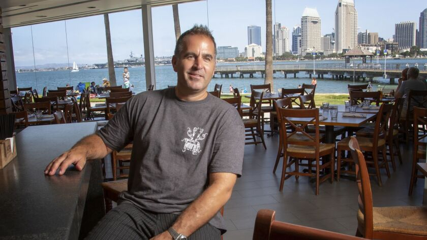 David Spatafore seated in the bar of the old Candelas on the Bay restaurant in Coronado. The restaurant opens Wednesday with a new name, el Roy's, and new management.