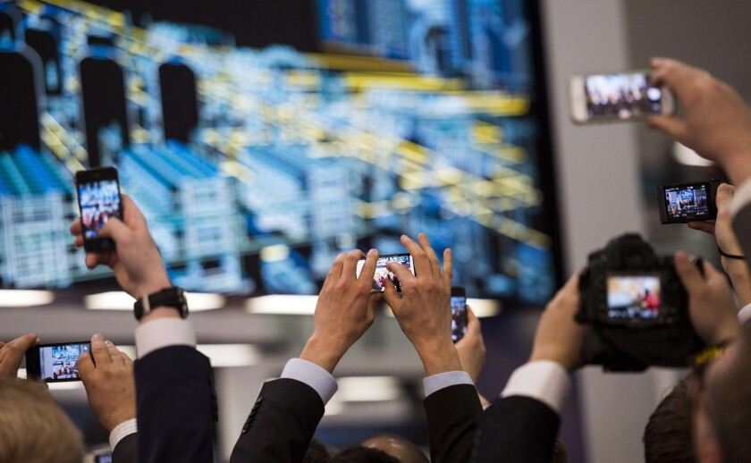 A report released Thursday said 4.5 million smartphones were lost or stolen in the U.S. in 2013. Above, guests and visitors take pictures with their smartphones during the opening of the Hannover Messe industrial trade fair in Hanover, Germany.
