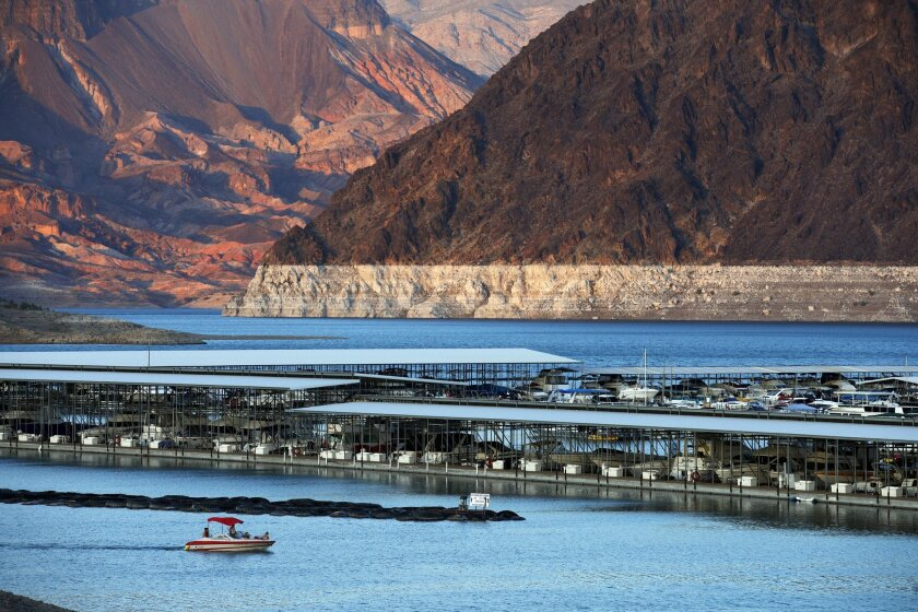 In this July 18, 2014 photo, the bathtub ring of light minerals that delineates the high water mark on Lake Mead is seen at Hemenway Harbor in the Lake Mead National Recreation Area in Nevada. A 14-year drought has caused the water level in the reservoir to shrink to its lowest point since it was first filled in the 1930s. (AP Photo/John Locher)
