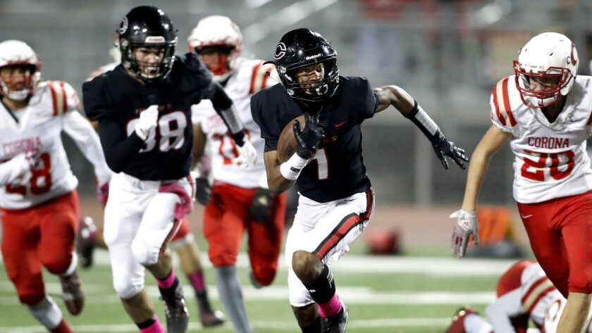 Corona Centennial wide receiver Gary Bryant evades Corona defenders for a touchdown in 2017.
