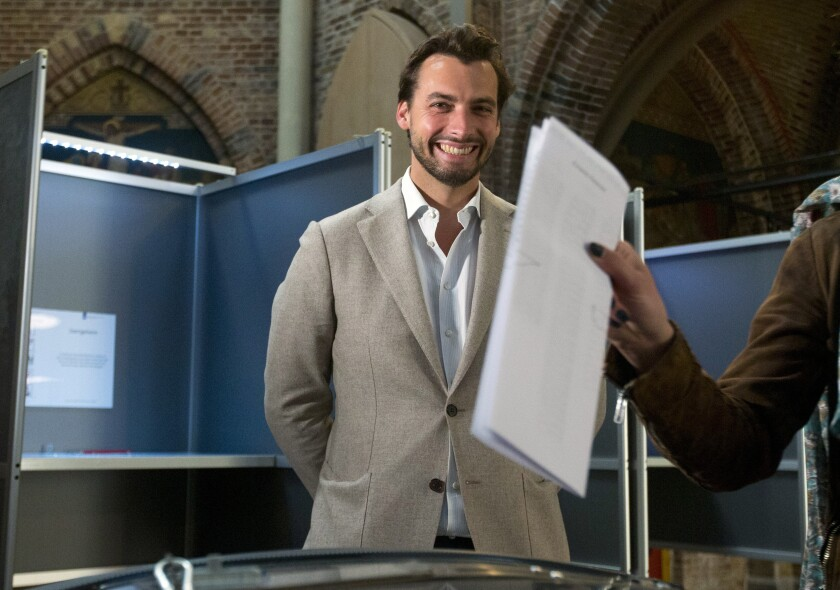 FILE - In this Thursday, May 23, 2019 file photo, Thierry Baudet, leader of the populist party Forum for Democracy, waits for his partner Davide Heijmans to cast her ballot for the European elections in Amsterdam. Members of a Dutch right-wing populist party have voted overwhelmingly in support of its leader, who stood down last month and then returned amid criticism of the way he handled accusations of extreme views among some members of the party's youth wing. In a referendum result announced Friday, Dec. 3, more than 76% of members of Forum For Democracy voted for Thierry Baudet to remain as party leader. (AP Photo/Peter Dejong, file)