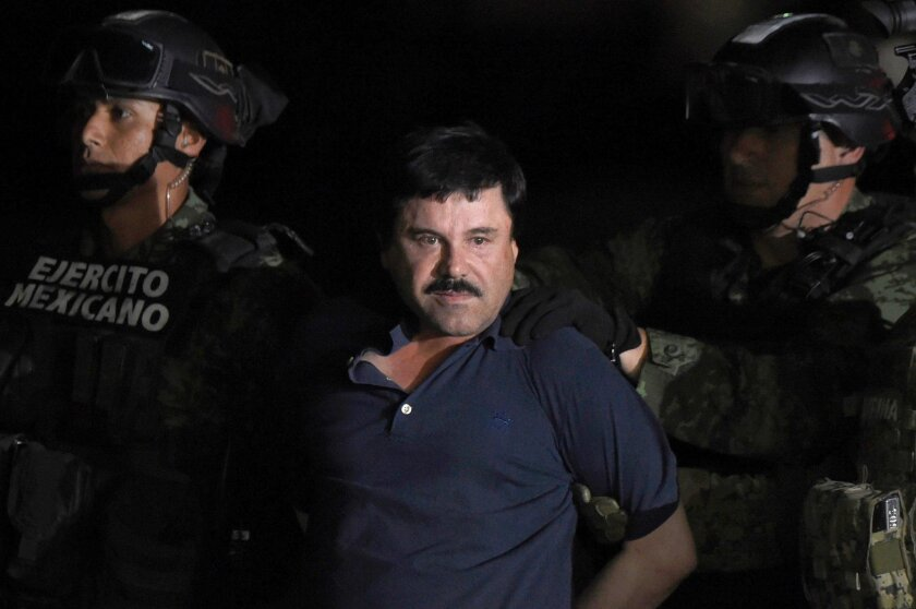 "Drug kingpin Joaquin ""El Chapo"" Guzman is escorted into a helicopter at Mexico City's airport Friday following his recapture during an intense military operation in Los Mochis, in Sinaloa State."